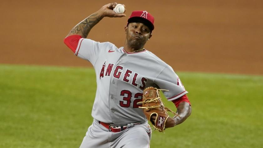 Los Angeles Angels relief pitcher Raisel Iglesias throws to the Texas Rangers during a baseball game in Arlington, Texas, Wednesday, April 28, 2021. (AP Photo/Tony Gutierrez)