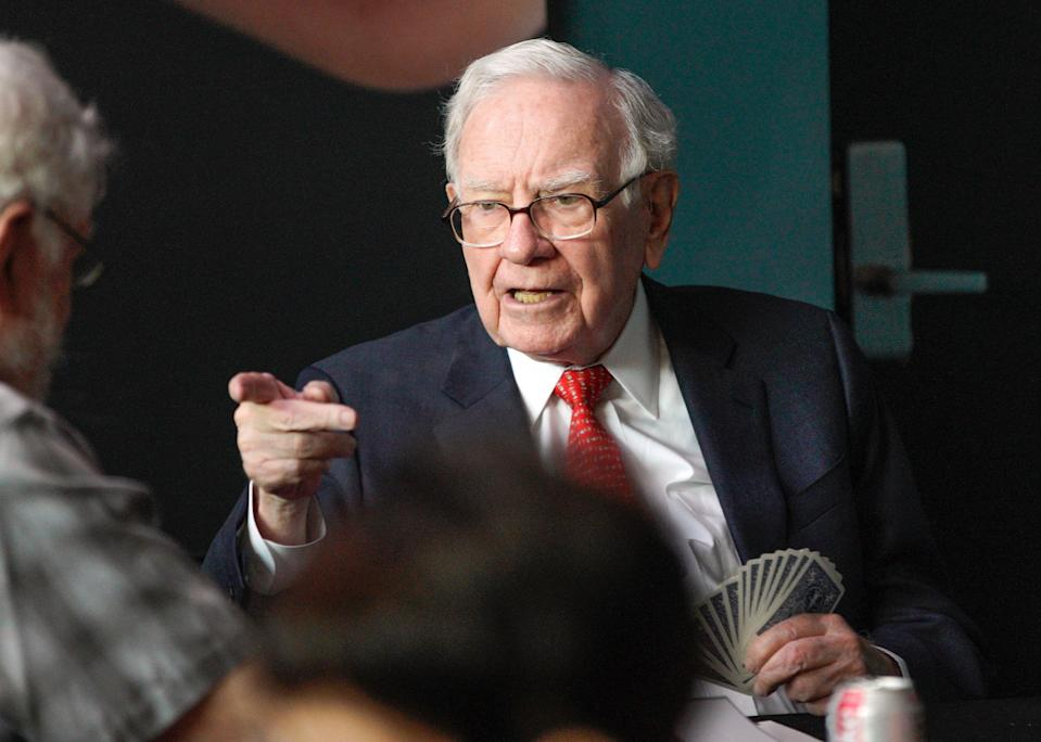 Warren Buffett, chairman and CEO of Berkshire Hathaway, gestures as he plays bridge outside Berkshire-owned Borsheims jewelry store in Omaha, Neb., Sunday, May 6, 2018. On Saturday, tens of thousands of Berkshire Hathaway shareholders attended the annual Berkshire Hathaway shareholders meeting. (AP Photo/Nati Harnik)