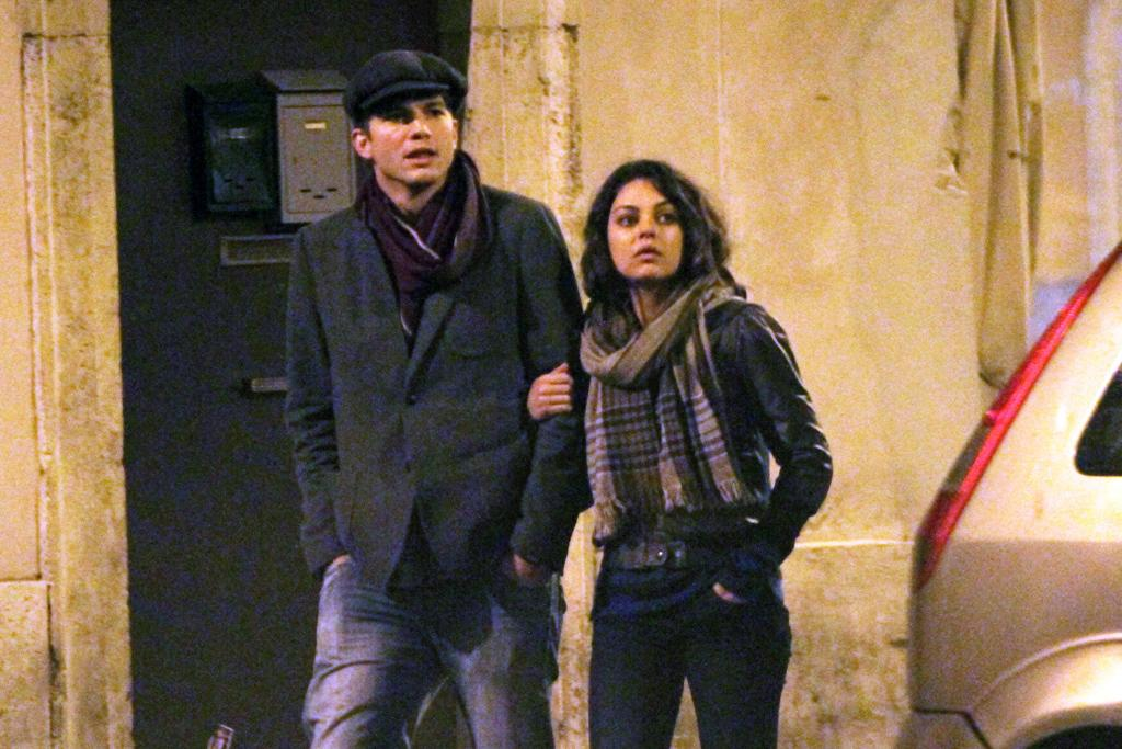 Ashton Kutcher and Mila Kunis strolling in Rome.