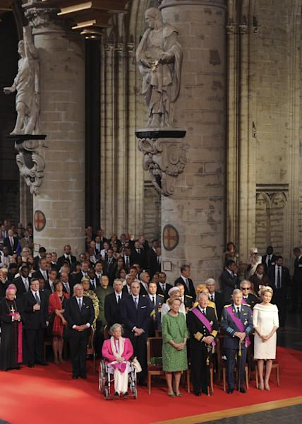 Royal family members from left front, Queen Fabiola, Queen Paola, King Albert II, Prince Philippe and his wife Princess Mathilde attend a church service at the St. Gudule cathedral in Brussels on Sunday, July 21, 2013. Belgium's King Albert II was set Sunday to relinquish the throne in a concession to his age and health, paving the way for his eldest son to become the country's seventh monarch. (AP Photo/Geert Vanden Wijngaert)