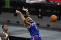 New York Knicks forward Obi Toppin (1) scores past San Antonio Spurs guard Lonnie Walker IV, left, during the second half of an NBA basketball game in San Antonio, Tuesday, March 2, 2021. (AP Photo/Eric Gay)