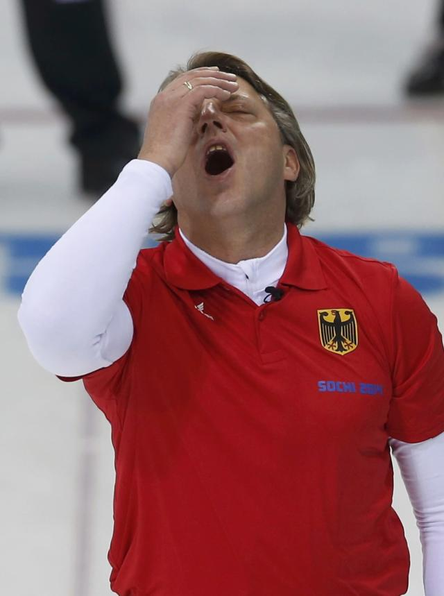 Germany's skip John Jahr reacts during their men's curling round robin game against Canada at the 2014 Sochi Olympics in the Ice Cube Curling Center in Sochi February 10, 2014. REUTERS/Mark Blinch (RUSSIA - Tags: OLYMPICS SPORT CURLING)