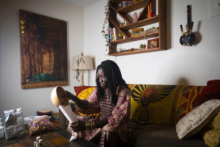 """Alua Arthur prepares herself a bath with rose petals and Epsom salt, part of her self-care ritual. <span class=""""copyright"""">(Francine Orr / Los Angeles Times)</span>"""