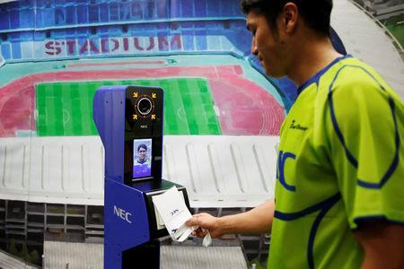 NEC Green Rockets' rugby player Teruya Goto demonstrates the face recognition system for Tokyo 2020 Olympics and Paralympics, which is developed by NEC corp, in Tokyo, Japan August 7, 2018. REUTERS/Toru Hanai
