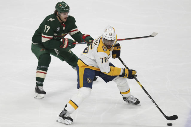 Nashville Predators' P.K. Subban controls the puck in front of Minnesota Wild's Marcus Foligno during the third period of an NHL hockey game Sunday, March 3, 2019, in St. Paul, Minn. The Predators won 3-2 in a shootout. (AP Photo/Stacy Bengs)