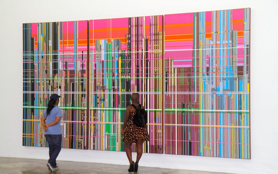 two people looking at colourful modern art - Jeff Greenberg