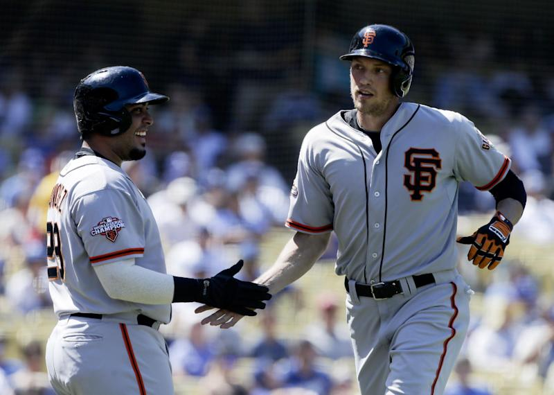 San Francisco Giants' Hunter Pence, right, celebrates his home run with Hector Sanchez against the Los Angeles Dodgers during second inning of a baseball in Los Angeles, Sunday, Sept. 15, 2013. (AP Photo/Chris Carlson)