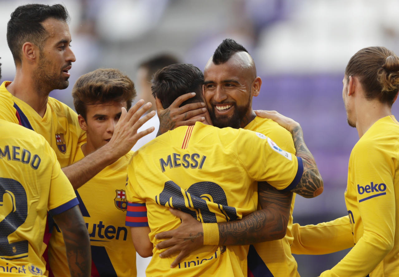 Barcelona's Arturo Vidal, second right, celebrates with teammates after scoring his side's first goal during the Spanish La Liga soccer match between Valladolid and FC Barcelona at the Jose Zorrilla stadium in Valladolid, Spain, Saturday, July 11, 2020. (AP Photo/Manu Fernandez)