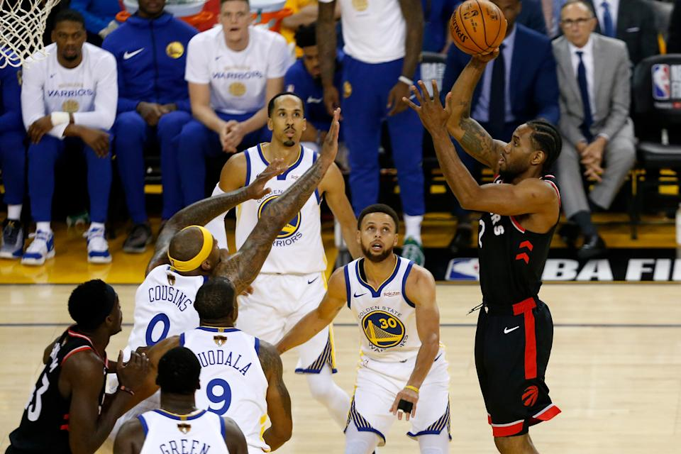 Kawhi Leonard #2 of the Toronto Raptors attempts a shot against the Golden State Warriors in the first half during Game Three of the 2019 NBA Finals at ORACLE Arena on June 05, 2019 in Oakland, California. (Photo by Lachlan Cunningham/Getty Images)