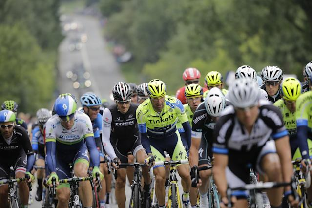The pack with Switzerland's Fabian Cancellara, center left in black, climbs during the sixth stage of the Tour de France cycling race over 194 kilometers (120.5 miles) with start in Arras and finish in Reims, France, Thursday, July 10, 2014. (AP Photo/Laurent Cipriani)