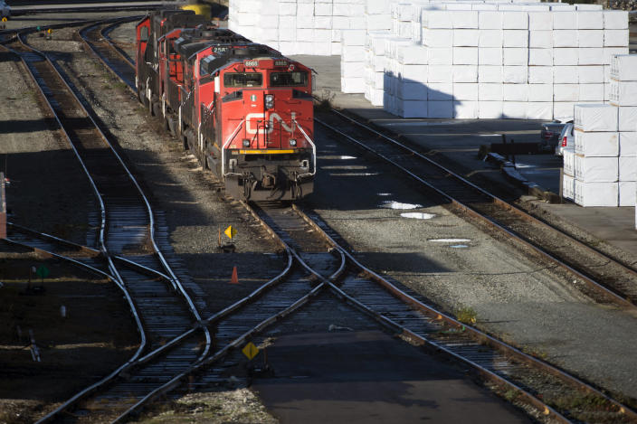 A quiet Mclean Rail Yard is pictured in North Vancouver, British Columbia, Wednesday, Nov. 20, 2019, as Canadian National rail workers strike outside the gates. Canadian National sweetened its offer to buy Kansas City Southern railroad Thursday, May 13, 2021, and derailed rival Canadian Pacific's bid for the railroad that handles traffic in the United States and Mexico. (Jonathan Hayward/The Canadian Press via AP)