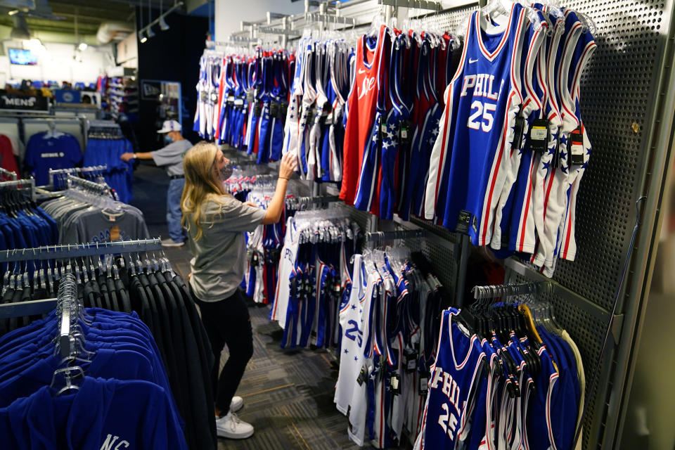 A fan shops for souvenirs before a preseason NBA basketball game between the Philadelphia 76ers and the Toronto Raptors, Thursday, Oct. 7, 2021, in Philadelphia. Ben Simmons was out of sight, out of mind and out of the team pregame hype video for the Philadelphia 76ers. The Sixers have largely stopped talking about the three-time All-Star guard.(AP Photo/Matt Slocum)