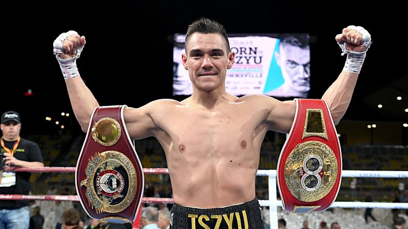 Pictured here, Tim Tszyu poses with his belts after beating Jeff Horn.