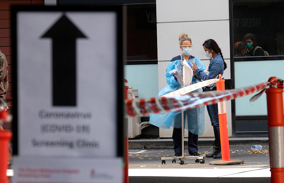Picture of workers outside a coronavirus clinic in Victoria, where people can go if they qualify for testing