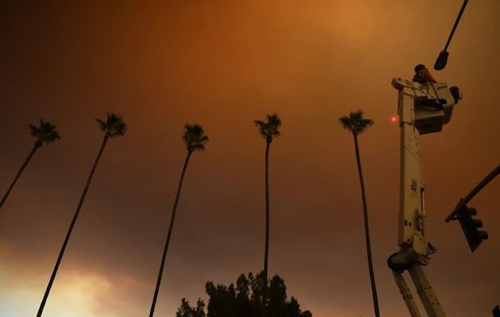 "A street camera is installed on a light post along North Azusa Avenue as smoke from the Bobcat fire fills the sky Wednesday morning. <span class=""copyright"">(Wally Skalij / Los Angeles Times)</span>"
