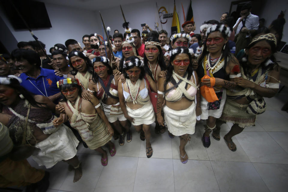 Waoranis dance in celebration after a judged ruled in their favor in a lawsuit filed against the Ministry of Non-Renewable Natural Resources for opening up oil concessions on their ancestral land, in Puyo, Ecuador, Friday, April 26, 2019. (AP Photo/Dolores Ochoa)
