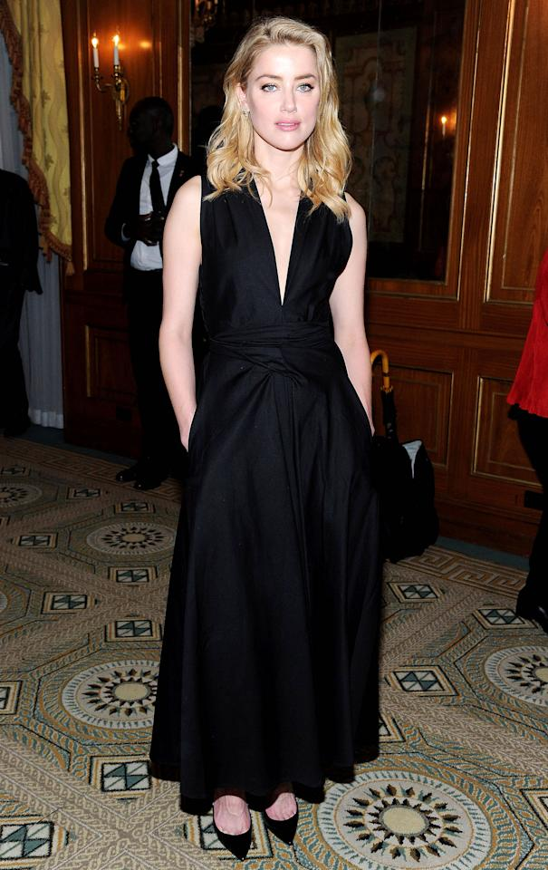 <p>Wearing a halter-neck, black Tome dress, Amber Heard looked elegant at the 8th Annual Official First Ladies Luncheon. [Photo: Rex] </p>