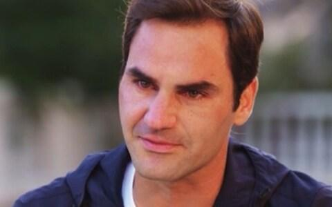 <span>A tearful Federer said during a television interview that he hoped Carter would have been proud of him</span> <span>Credit: CNN </span>