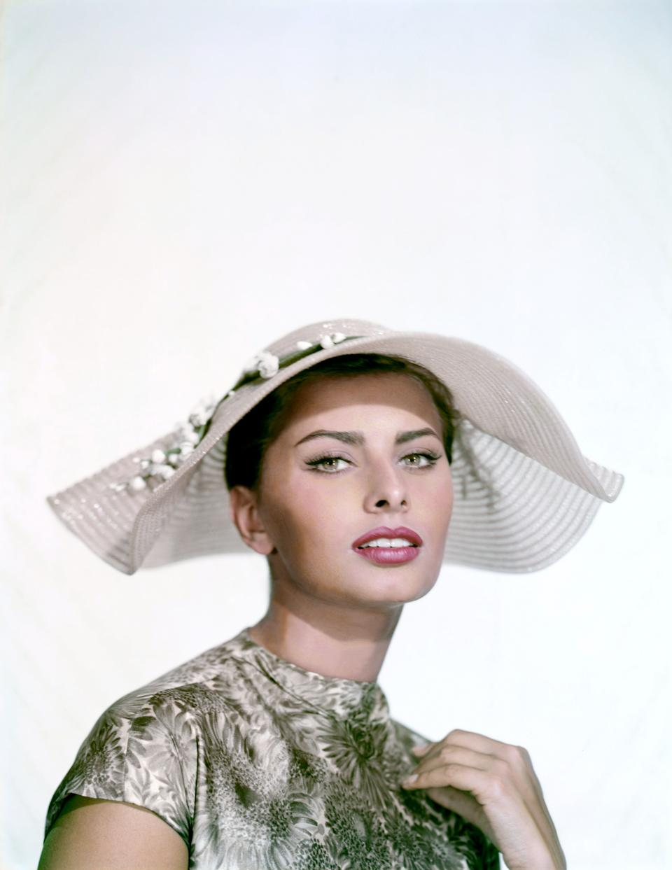 The actress wears flower-trimmed hat in this undated photo.