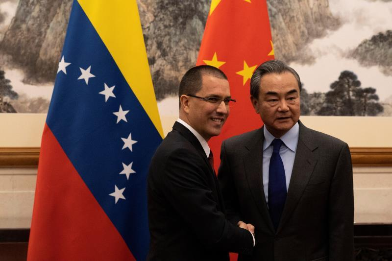 Venezuela's Foreign Minister Jorge Arreaza (L) meets with Chinese Foreign Minister Wang Yi (R) at the Diaoyutai State Guest House in Beijing, China, 16 January 2020. EFE/EPA/Ng Han Guan / POOL