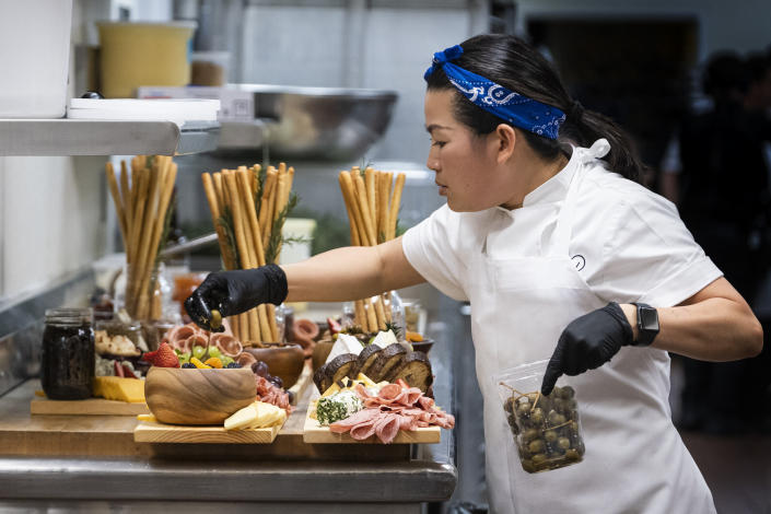 """This image released by HBO Max shows Chef Pauline in a scene from the four-part documentary series, """"The Event,"""" which shows the intense planning and details that go into high-profile catering. The series premieres on HBO Max on Jan. 14. (Jessica Brooks/HBO Max via AP)"""