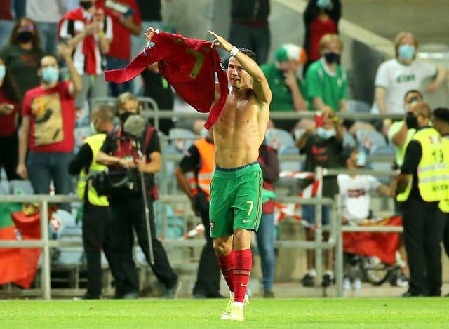 Cristiano Ronaldo holds up his shirt to the fans after scoring