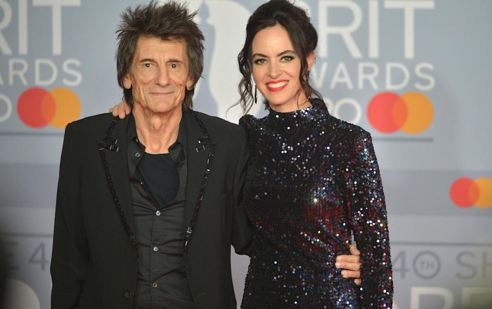 Ronnie Wood with his wife, Sally Humphreys, last year - Getty