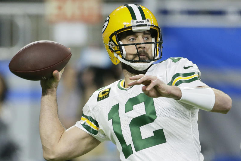 FILE - In this Dec. 29, 2019, file photo, Green Bay Packers quarterback Aaron Rodgers throws during the first half of an NFL football game against the Detroit Lions, in Detroit. Two of the best at their jobs will meet once again in the NFC championship game when Green Bay quarterback Aaron Rodgers must decide how much to challenge San Francisco cornerback Richard Sherman. (AP Photo/Duane Burleson, File)