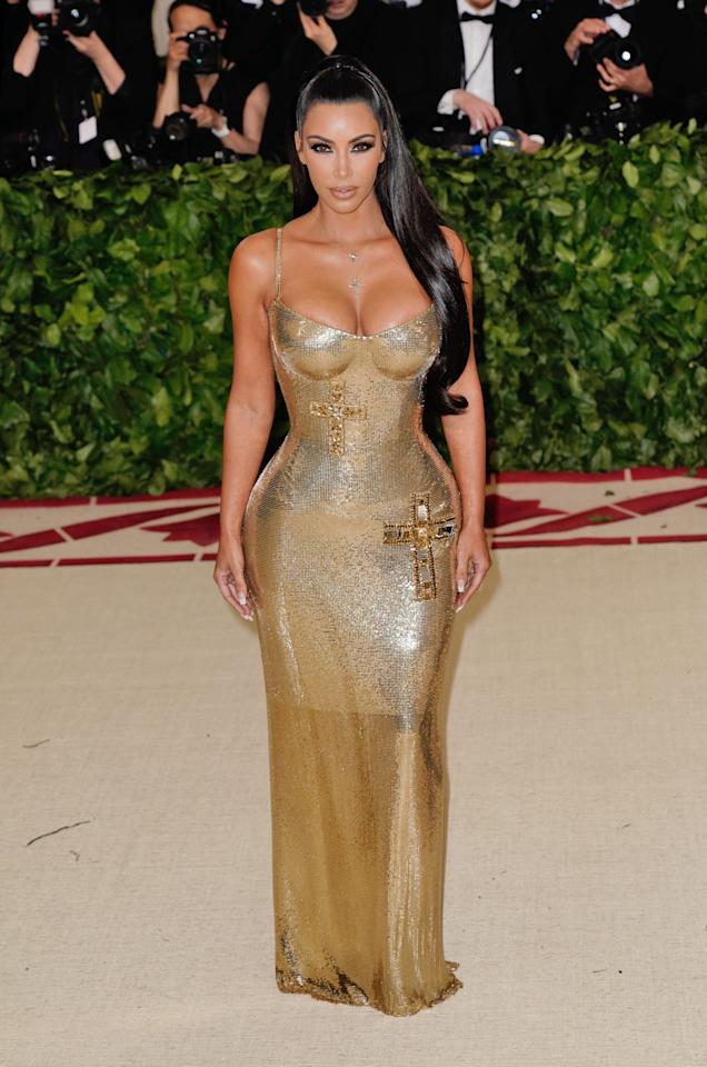 <p>For the 2018 Met Gala, Kim Kardashian donned a gold chainmail dress by Versace. <em>[Photo: Getty]</em> </p>