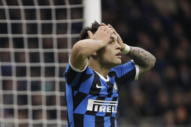 Inter Milan's Lautaro Martinez reacts after missing a chance to score during an Italian Cup soccer match between Inter Milan and Napoli at the San Siro stadium, in Milan, Italy, Wednesday, Feb. 12, 2020. (AP Photo/Luca Bruno)