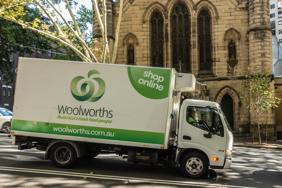 Woolworths delivery truck parked outside a building. Source: Getty Creative