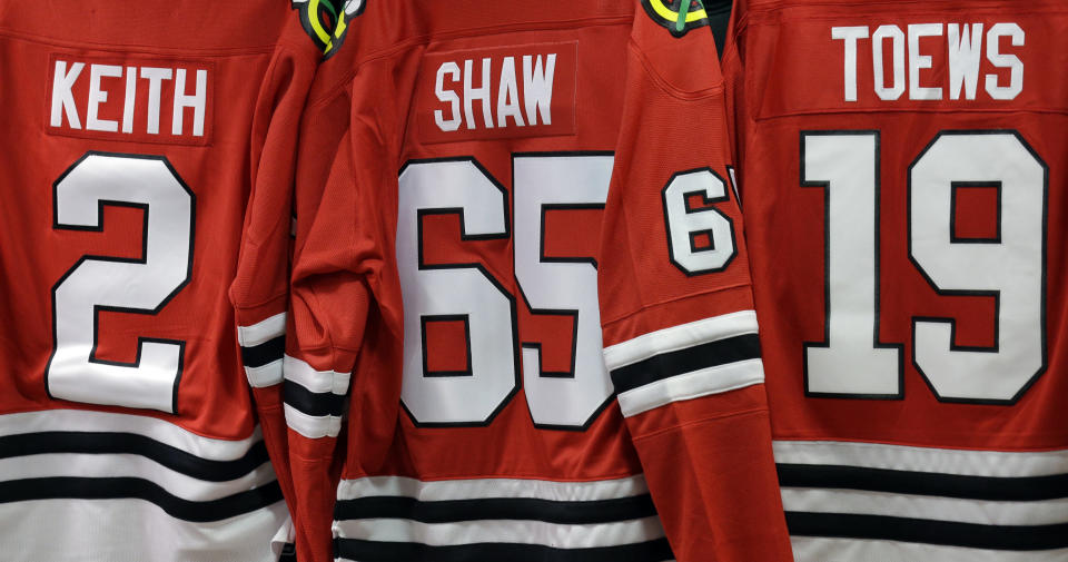 FILE - In this May 28, 2014, file photo, Chicago Blackhawks jerseys are displayed at a store inside of the United Center at Game 5 of the Western Conference finals in the NHL hockey Stanley Cup playoffs between the Blackhawks and the Los Angeles Kings in Chicago. Jersey advertisements are coming to the NHL. The league will allow teams to put sponsor patches on jerseys beginning with the 2022-23 season after the board of governors unanimously approved the move, according to a person with knowledge of a memo sent this week. The person spoke to The Associated Press on condition of anonymity Tuesday, Aug. 17, 2021, because the league had not announced the decision. (AP Photo/Nam Y. Huh, File)