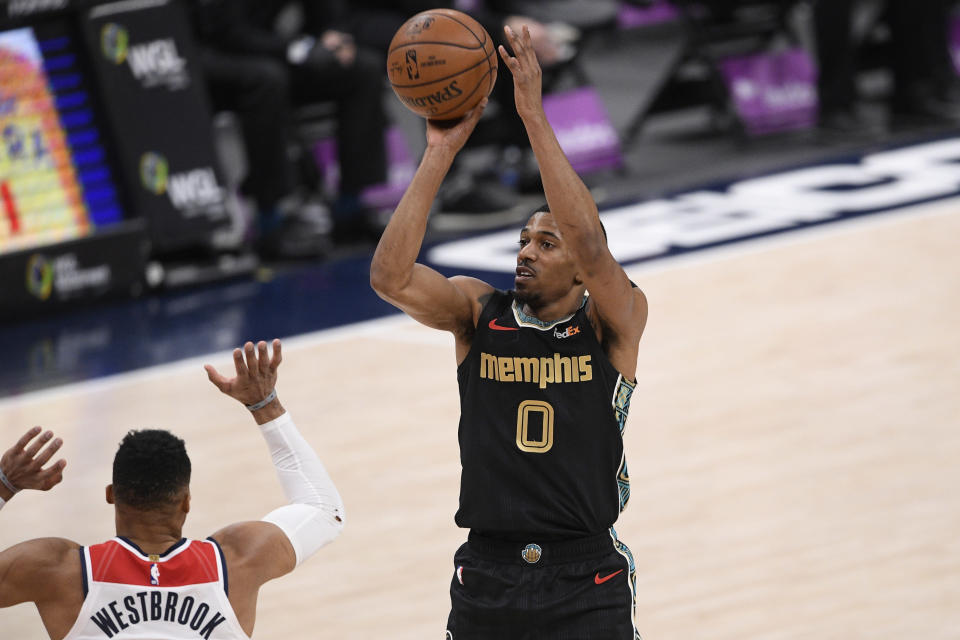 Memphis Grizzlies guard De'Anthony Melton (0) shoots against Washington Wizards guard Russell Westbrook (4) during the first half of an NBA basketball game, Tuesday, March 2, 2021, in Washington. (AP Photo/Nick Wass)