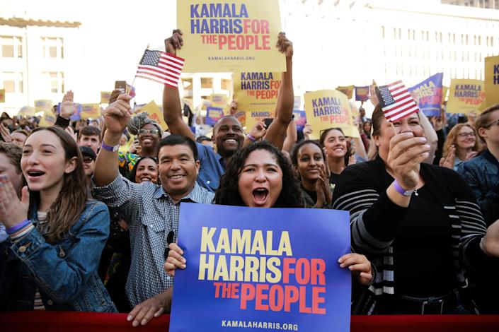 Supporters cheer while listening to U.S. Senator Kamala Harris speak at the launch of her campaign for President of the United States at a rally at Frank H. Ogawa Plaza in her hometown of Oakland, California, U.S., January 27, 2019.  REUTERS/Elijah Nouvelage