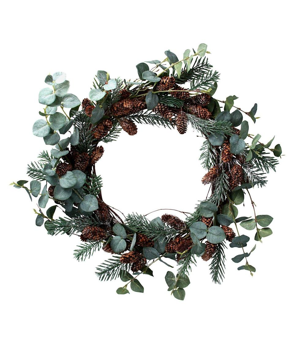 "<p>This wreath from the famous London store offers a natural look but with a much longer shelf life. With faux fir, eucalyptus and pine cones, this is a design that will look stylish year and year. Place it on a door, or use as the centre of a festive table setting. £39.95, <a href=""https://www.libertylondon.com/uk/fir-cone-wreath-000699342.html"" rel=""nofollow noopener"" target=""_blank"" data-ylk=""slk:libertylondon.com"" class=""link rapid-noclick-resp"">libertylondon.com </a></p>"