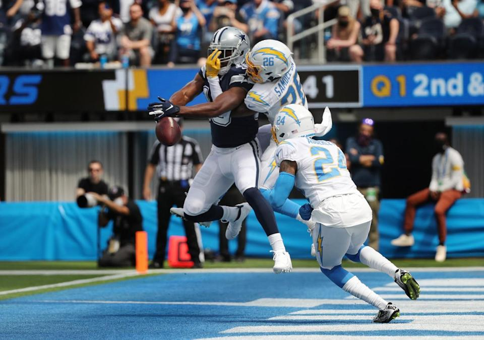 Chargers' Asante Samuel Jr. breaks up a pass intended for Cowboys receiver Amari Cooper (19) in the end zone.