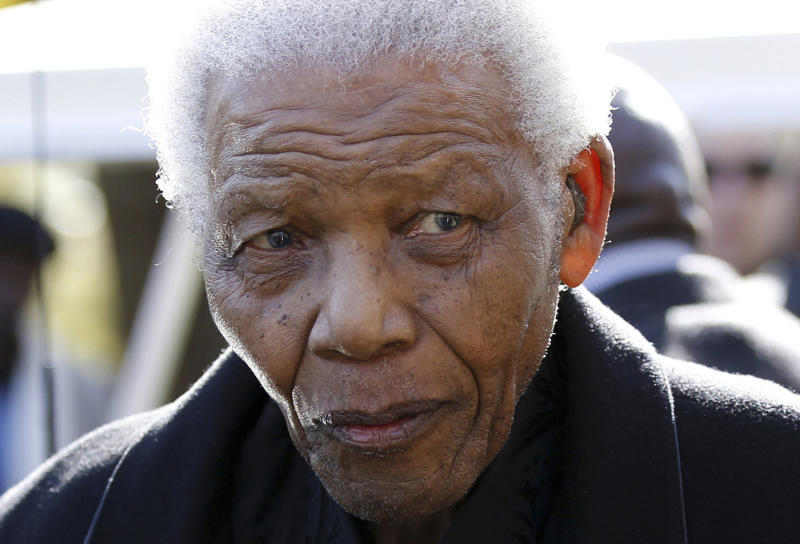 FILE - In this June 17, 2010 file photo, former South African President Nelson Mandela leaves the chapel after attending the funeral of his great-granddaughter Zenani Mandela in Johannesburg, South Africa. The South African presidency says Nelson Mandela was re-admitted to hospital with a recurrence of a lung infection Thursday March 28, 2013.  (AP Photo/Siphiwe Sibeko, Pool, File)