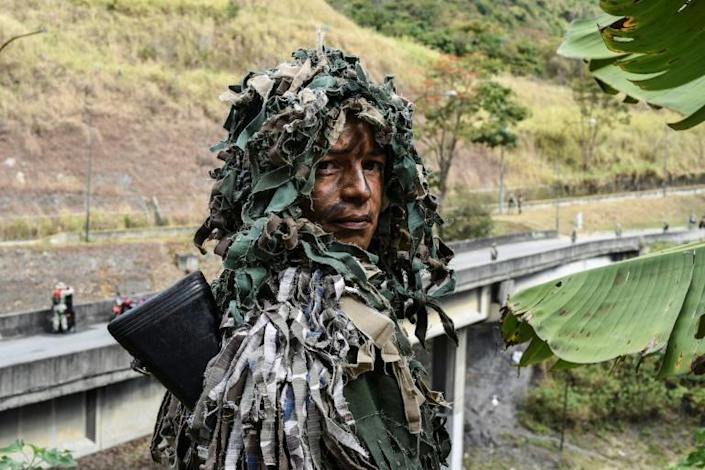 """Ismaira Figueroa, a sniper for the Bolivarian militia, poses while taking part in military exercises for the """"Bolivarian Shield 2020 Operation"""" in Caracas"""