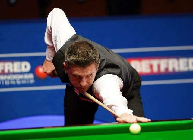 England's Mark Selby plays a shot during the semi-final