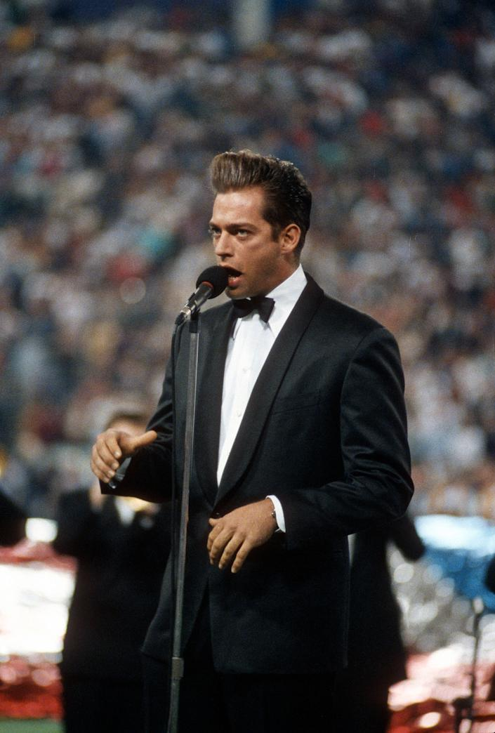 Harry Connick Jr sings the National Anthem prior to Super Bowl XXVI between the Washington Redskins and Buffalo Bills at the Metrodome in Minneapolis, Minnesota January 26, 1992. The Redskins won the Super Bowl 37-24.