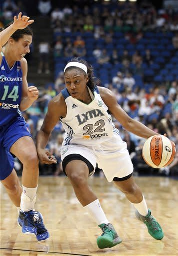 Minnesota Lynx guard Monica Wright (22) drives against New York Liberty forward Nicole Powell (14) during the second half of a WNBA basketball game, Thursday, June 21, 2012, in Minneapolis. The Lynx won 102-70. (AP Photo/Stacy Bengs)