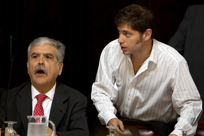 Argentina's Planning Minister Julio De Vido, left, and Vice Economy Minister Axel Kicillof, who were appointed by President Cristina Fernandez to handle the expropriation of the YPF oil company, arrive to Congress which is discussing a bill proposed by Fernandez to gain control of Argentina's energy reserves in Buenos Aires, Argentina, Tuesday April 17, 2012.  Fernandez pushed forward a bill to renationalize the country's largest oil company on Monday despite fierce criticism from abroad and the risk of a major rift with Spain. Fernandez said the legislation put to congress would give Argentina a majority stake in oil and gas company YPF by taking control of 51 percent of its shares currently held by Spain's Repsol. (AP Photo/Natacha Pisarenko)