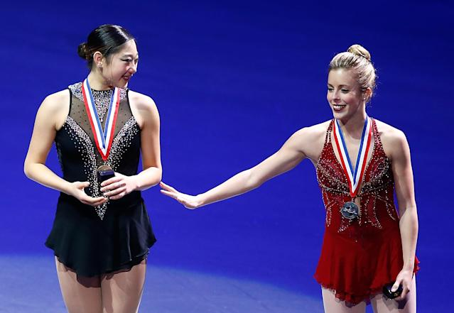 BOSTON, MA - JANUARY 11: Mirai Nagasu (L) and Ashley Wagner (R) stand at the podium during the medal ceremony following the free skate program during the 2014 Prudential U.S. Figure Skating Championships at TD Garden on January 11, 2014 in Boston, Massachusetts. (Photo by Jared Wickerham/Getty Images)