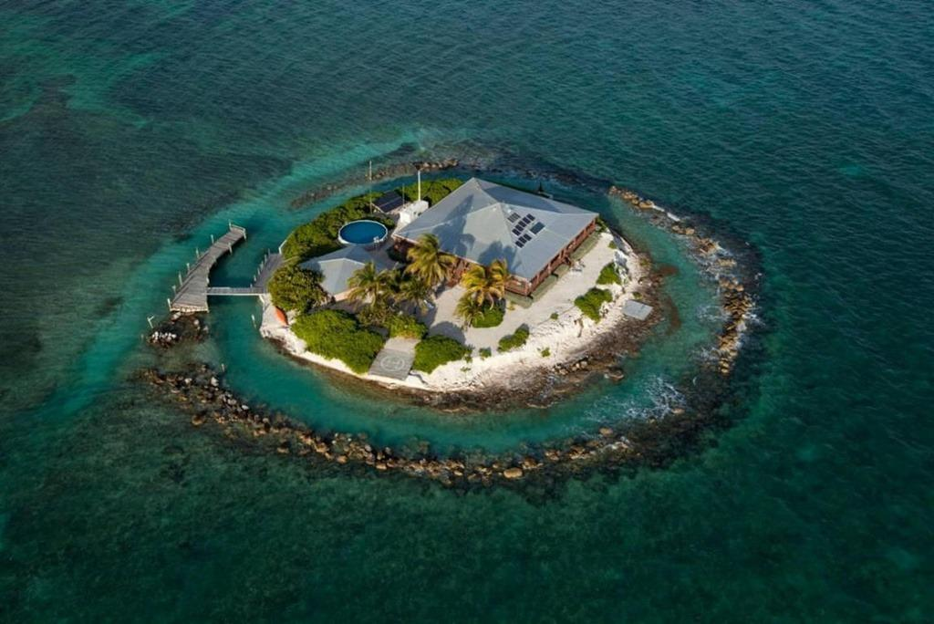 "<p>The island is surrounded by a coral reef, and there are plenty more worth exploring around the island, <a href=""http://bit.ly/1n8wzv9"" target=""_blank"">the rental listing says</a>. The property also includes a helipad and above-ground pool.<i> </i>(Photo: <a href=""http://bit.ly/1UaeIPm"" target=""_blank"">Coldwell Banker listing</a>)</p>"