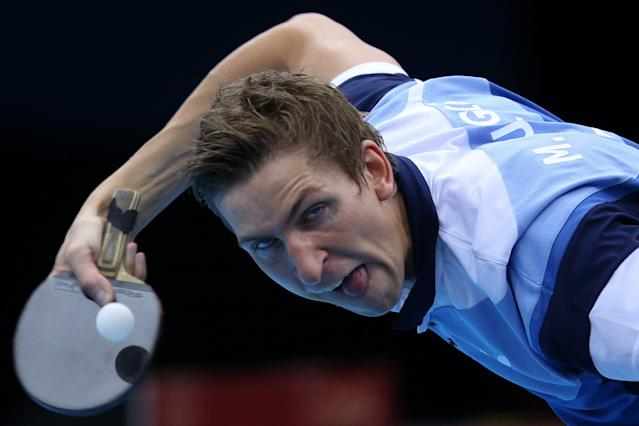LONDON, ENGLAND - JULY 29: Matiss Burgis of Latvia plays a forehand in his Men's Singles second round match against Alexey Smirnov of Russia on Day 2 of the London 2012 Olympic Games at ExCeL on July 29, 2012 in London, England. (Photo by Feng Li/Getty Images)
