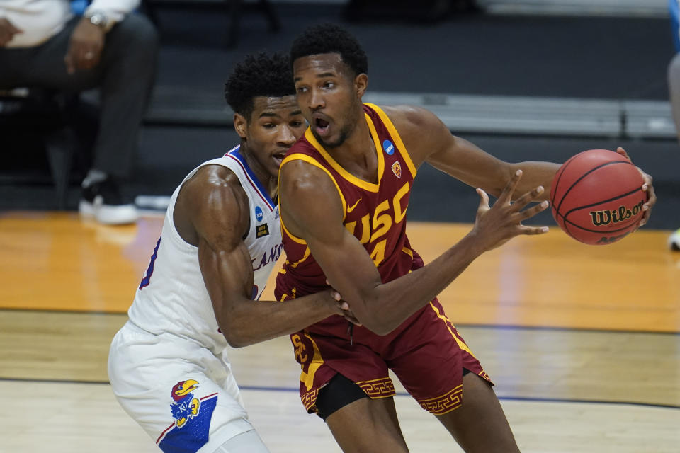 USC forward Evan Mobley (4) drives on Kansas guard Ochai Agbaji (30) during the first half of a men's college basketball game in the second round of the NCAA tournament at Hinkle Fieldhouse in Indianapolis, Monday, March 22, 2021. (AP Photo/Paul Sancya)