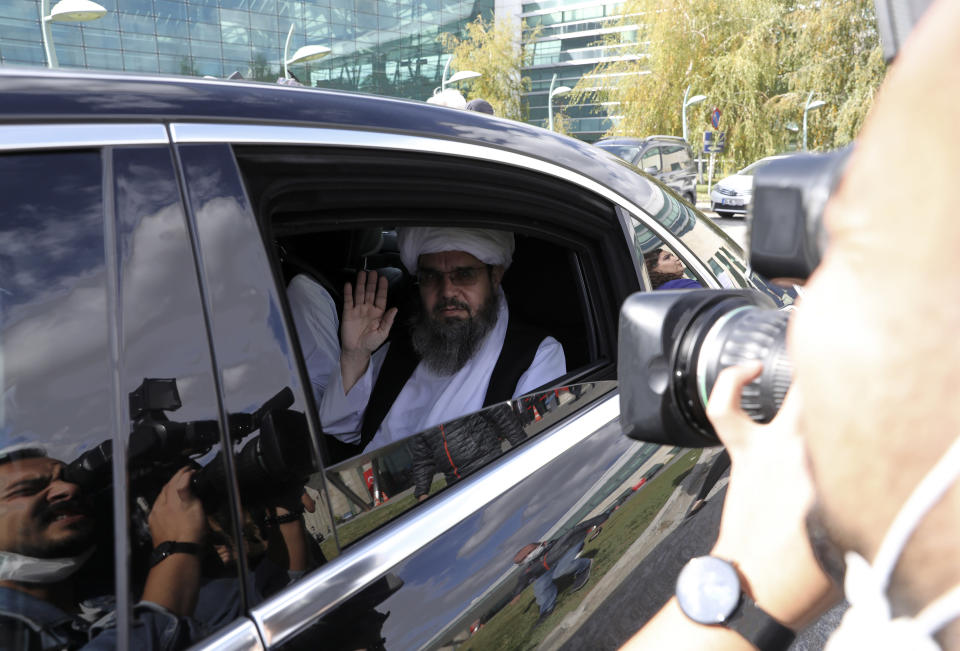 The Taliban delegation led by Amir Khan Muttaqi, the acting foreign minister, sit in a car at Esenboga Airport, in Ankara, Turkey, Thursday, Oct. 14, 2021. A high-level delegation of Afghanistan's new Taliban rulers has arrived in Turkey for talks with Turkish officials, the Foreign Ministry announced Thursday. The meetings in the capital of Ankara would be first between the Taliban and senior Turkish government officials after the group seized control of Afghanistan. (AP Photo/Burhan Ozbilici)