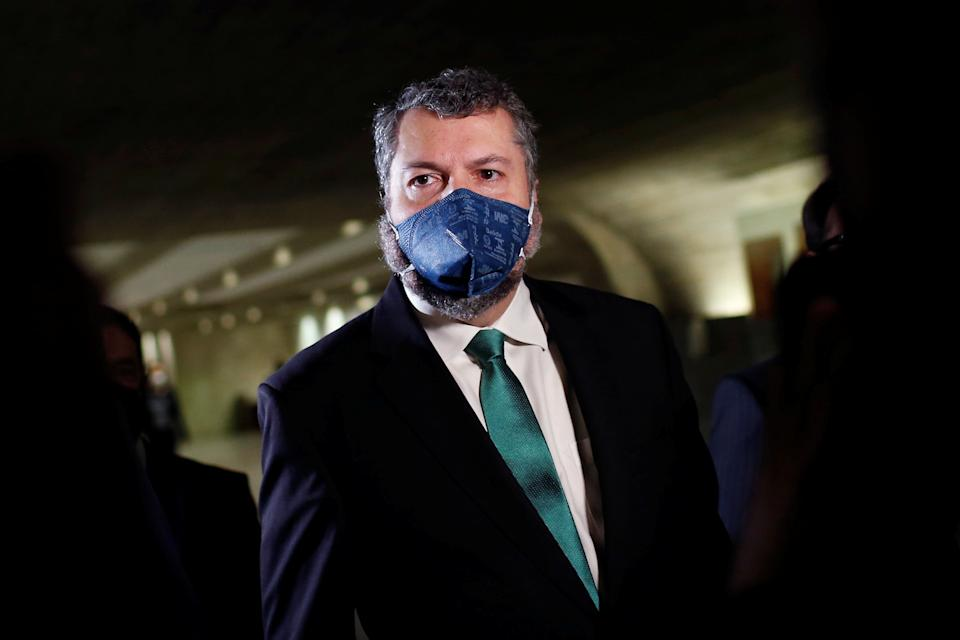 Brazil's former Foreign Minister Ernesto Araujo walks before a meeting of the Parliamentary Inquiry Committee (CPI) to investigate government actions and management during the coronavirus disease (COVID-19) pandemic, at the Federal Senate in Brasilia, Brazil May 18, 2021. REUTERS/Adriano Machado