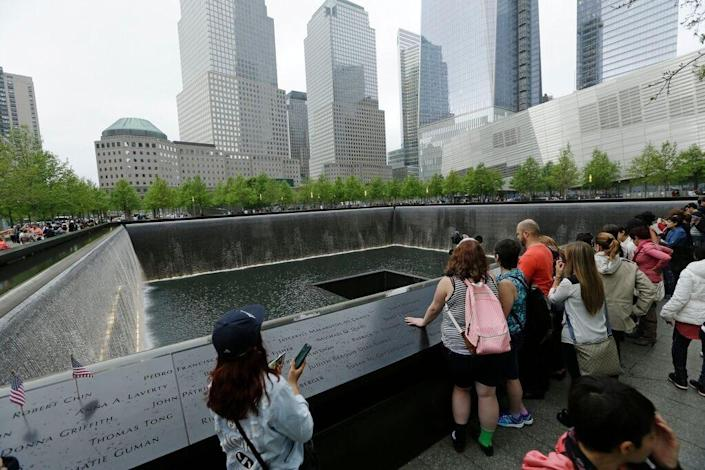 In this May 15, 2014, file photo, patrons visit the pools at The 9/11 Memorial near the World Trade Center in New York.