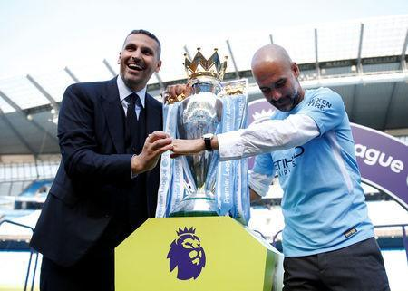 Soccer Football - Premier League - Manchester City vs Huddersfield Town - Etihad Stadium, Manchester, Britain - May 6, 2018 Manchester City manager Pep Guardiola and chairman Khaldoon Al Mubarak celebrate with the trophy after winning the Premier League title Action Images via Reuters/Carl Recine